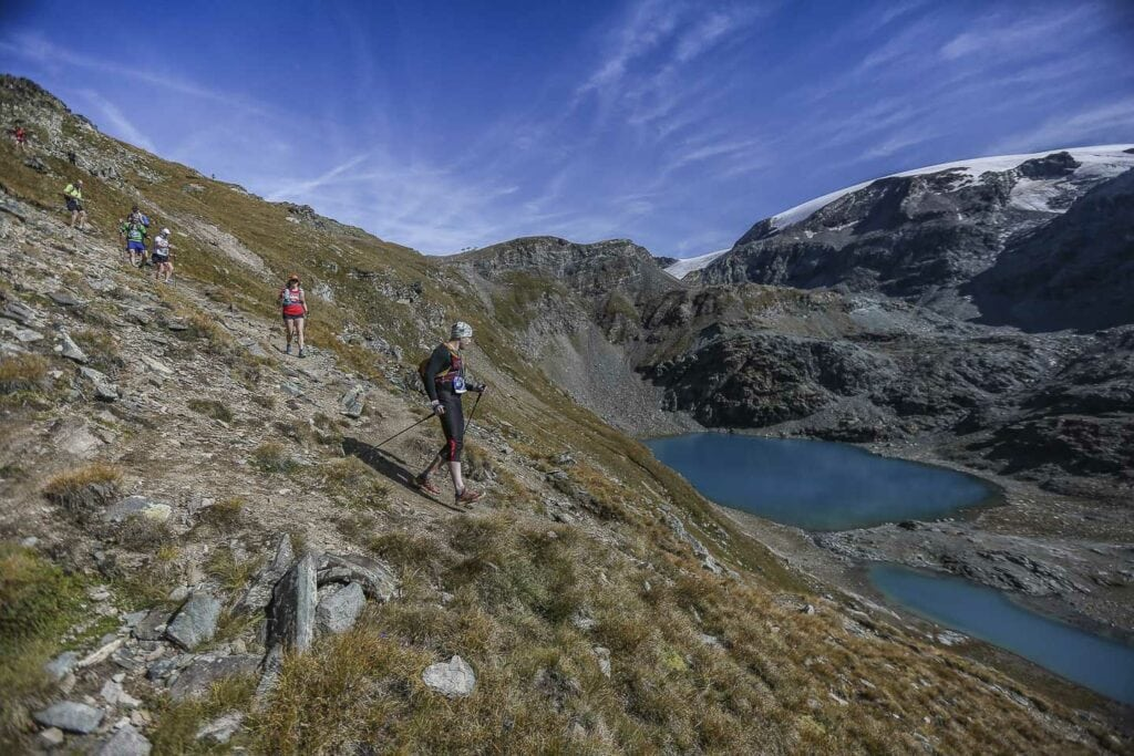 runing past turquoise lakes to gressoney